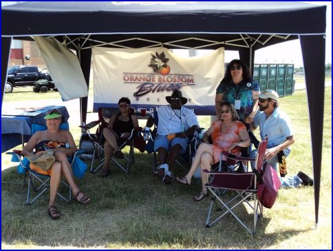 Orange Blossom Blues Society tent and members