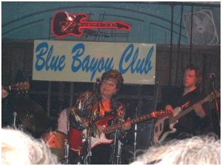 EG Kight jammin' with her band